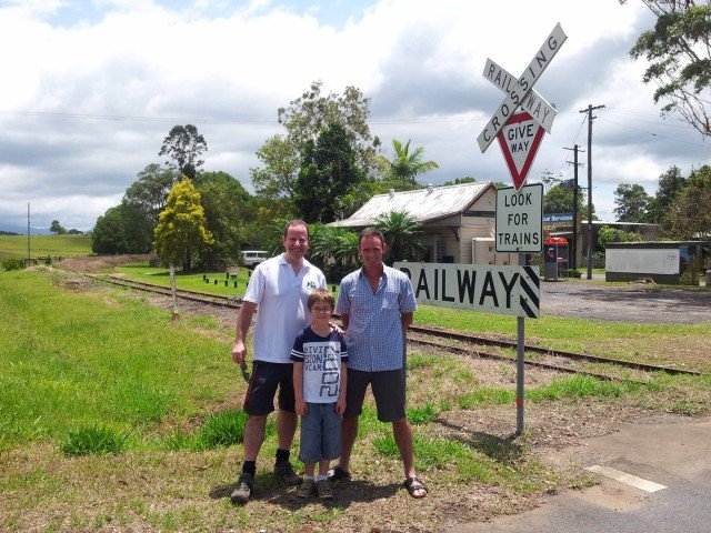 ice-President of Rail Trails Australia, Steven Kaye (left) alongside the rail line at Stokers Siding, with Northern Rivers Rail Trail Vice-President Steve Martin and son Jackson. Photo Tweed Shire Council