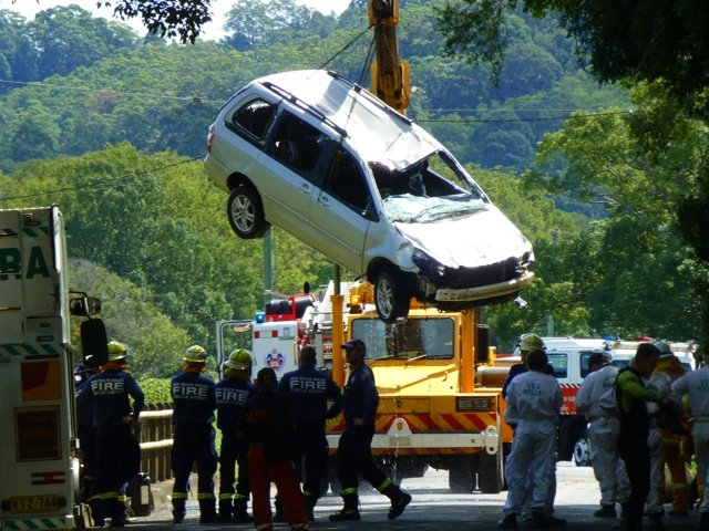 A car which a woman had been driving on main Arm Road near Mullumbimby is pulled out of the flood-affected river. Photo Peter Leishman