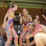 Splashing on the body paint before the World Nude Bike Ride in Byron Bay. Photo Jeff 'Threadbare' Dawson