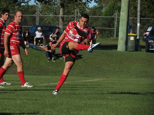 Byron's full-back Jared De Thierry kicks on the fifth at Byron.