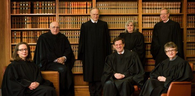 Justices of the High Court of Australia: (standing, left to right) Justice Heydon AC, Justice Crennan AC, Justice Hayne AC; (seated, left to right) Justice Kiefel, Justice Gummow AC, Chief Justice French AC, Justice Bell.