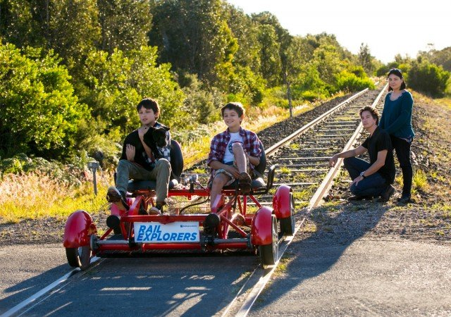 James and Charlie, with parents Alex and Mary-Joy, show how much fun rail carts would be if they were given the go-ahead. Photo Jeff 'Carted Off Since 1986' Dawson