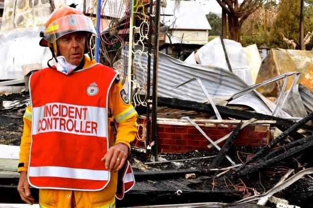 Incident controller Robbie Graham, group officer of the North East Rural Fire Service, surveys the damage. (Darren Coyne)