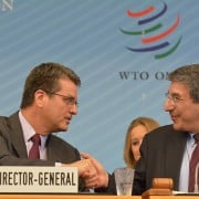 WTO director-general Roberto Azevêdo, left, shakes hands with the General Council chairman Jonathan T Fried of Canada after the agreement is reached. Image from www.wto.org