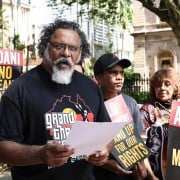 Traditional owner Adrian Burragubba announces the W&J resistance to the Adani Carmichael mine. Photo supplied.