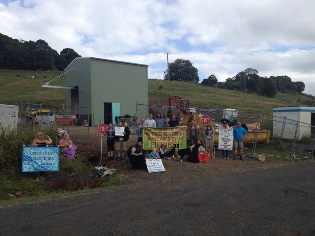 Protestors at the entrance of the fluoride dosing plant at Corndale, which has been shut down on a number of occasions after leaks were discovered. (Pic supplied)