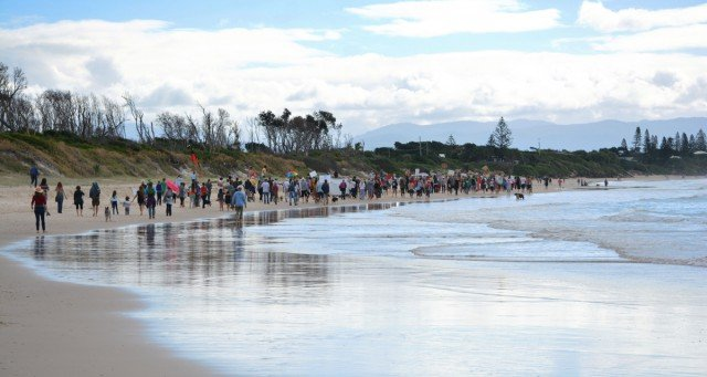 Despite the weather, some 300 people took to Byron's Main Beach on Sunday to show their opposition to the construction of a rock wall at Belongil. Photo Sean O'Shea