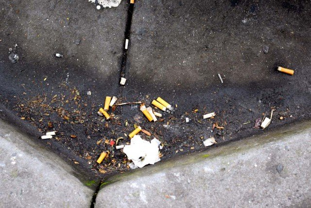 Cigarette butts are tossed into the street as a result of smoking bans in the Lismore CBD. (Darren Coyne)