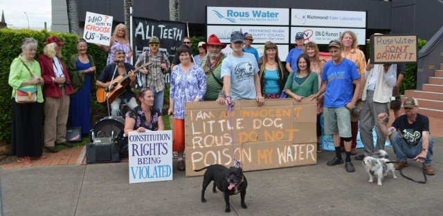 Anti fluoride protesters outside Rous Water yesterday. (Picture Robert Hearne)
