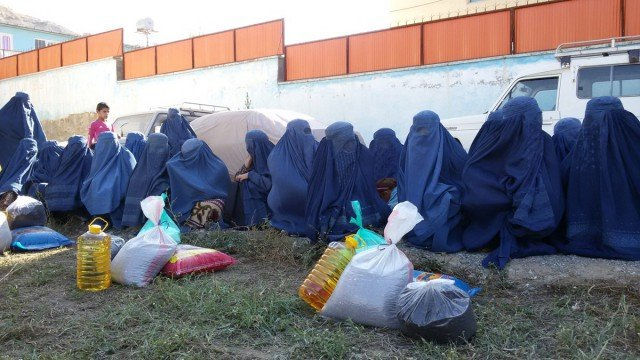 Burqa clad Afghan women who fled from neighboring Kunduz province, wait to receive free rations in Badakhshan, Afghanistan,on Monday, October 5. Charity organisation MSF has described the US bombing of a hospital in Kunduz that killed 22 people as a 'war crime'. EPA/Muhammad Sharif