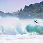 Surfing or flying? Big surf at Byron Bay on the weekend, whipped up by tropical cyclone Winston, saw most stay clear of the water but a brave few take to the waves. Photo Sean O'Shea