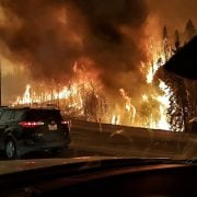 A picture provided by Twitter user @jeromegarot on May 5 shows the wildfire raging through the town of Fort McMurray, Canada. Photo EPA/Twitter.come/Jeromegarot