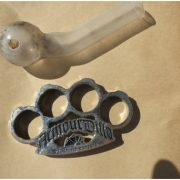 Knuckle-dusters and a smoking pipe. (supplied)