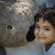 Sydney lad four-year-old Ethan was very happy to snuggle up to a giant koala at Sunay's Big Scrub event. Photo Tree Faerie.