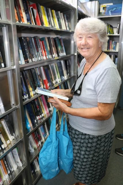 Kathleen Howard of Tweed Heads South browses the Richmond Tweed Mobile Library collection. Photo Tweed Shire Council