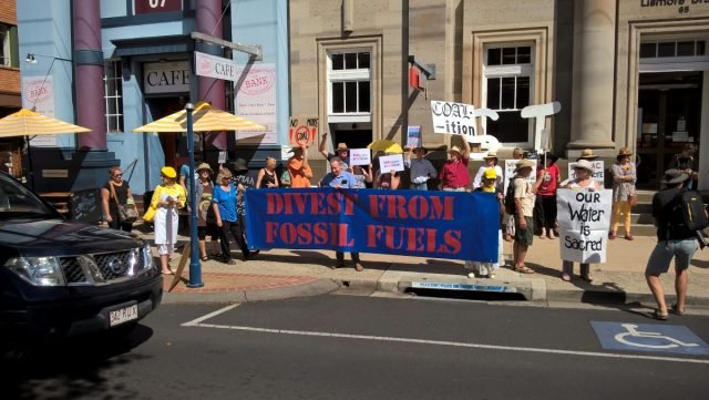 Protesters outside Westpac in Lismore asking for Westpac not to fund the Adani coal mine. Photo supplied.