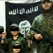 Khaled Sharrouf and young children in a propaganda video. Photo ABC