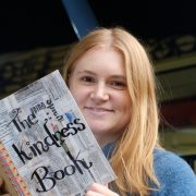 Rebecca Johnson shows off her Kindness Book, a record of kind gestures. Photo Jeff Dawson