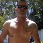 Thirty-three year-old Phil Becker has been charged with the murder of alleged debt enforcer Ace Hall (pictured) in Tweed Heads. Photo Facebook