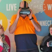 Lisa, Garth and Kathleen try the new VR gear on for size and sight. Photo Supplied.