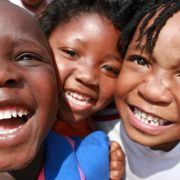 The smiling faces of the children at Windmill Park in South Africa. Photos supplied