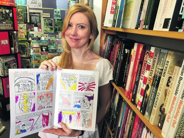 Holly English with her new self-published comic book TheBook of Wonder. Photo Hans Lovejoy