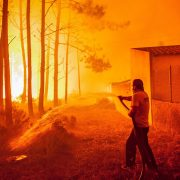A man fights with a forest fire in Vieira de Leiria, Marinha Grande, center of Portugal, 16 October 2017. 6,000 firemen supported by 1,800 land vehicules are fighting several wildfires all over the country. EPA/RICARDO GRACA